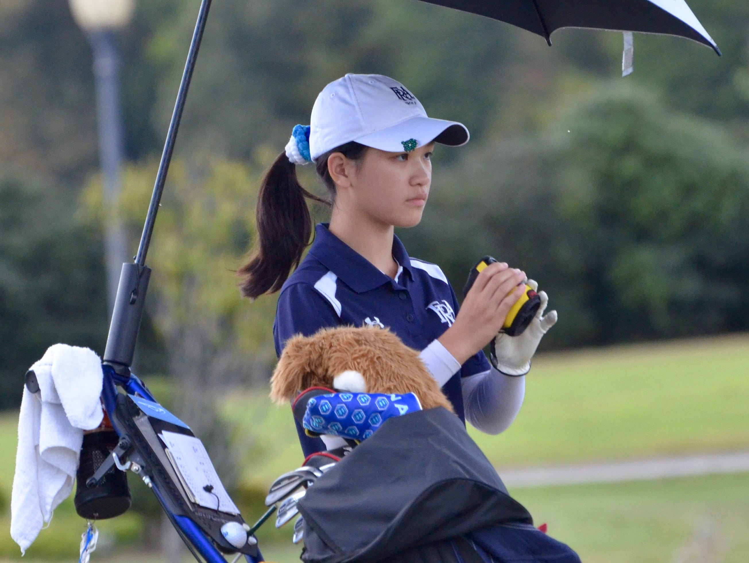 FRA's Angelina Chan uses her RangeFinder during Tuesday's championship round at WillowBrook Golf Club.