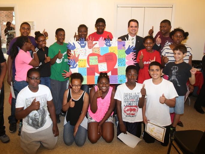 Students who participated in the Waldron Terrace homework club celebrate the end of their school year at the Waldron Community Room in Nyack June 5, 2014.