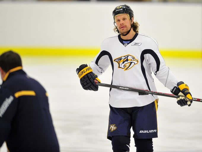 Predators forward Olli Jokinen looks at Coach Peter Laviolette during practice on Sept. 22, 2014.