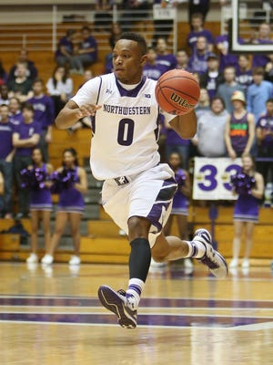 Northwestern Wildcats guard Johnnie Vassar (0) brings the ball up the court during the game against the Elon Phoenix at Welsh-Ryan Arena.