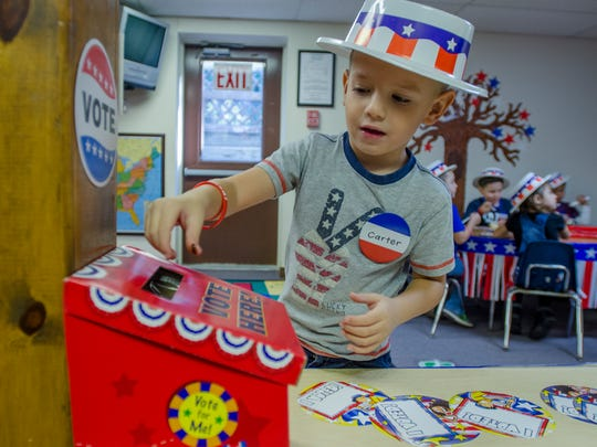 Carter Moyer casts his vote for president with his ice cream label Monday, Nov. 7, during an election day ice cream party at the Marysville Children's Center.
