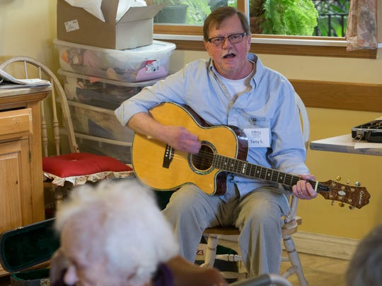 Terry Sexton sings at St. Ann Center for Intergenerational Care on the south side. Sexton was diagnosed with Parkinson's disease, but he finds volunteering at the center is good for him and clients at the center.