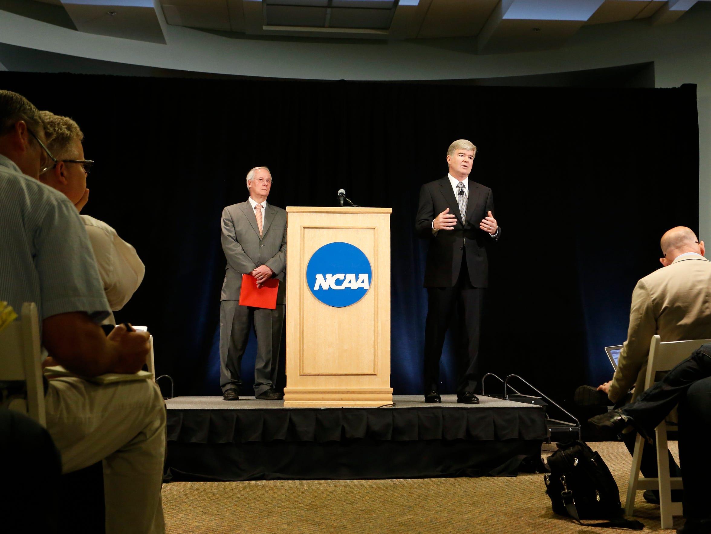 NCAA President Mark Emmert, left, and Ed Ray, chairman