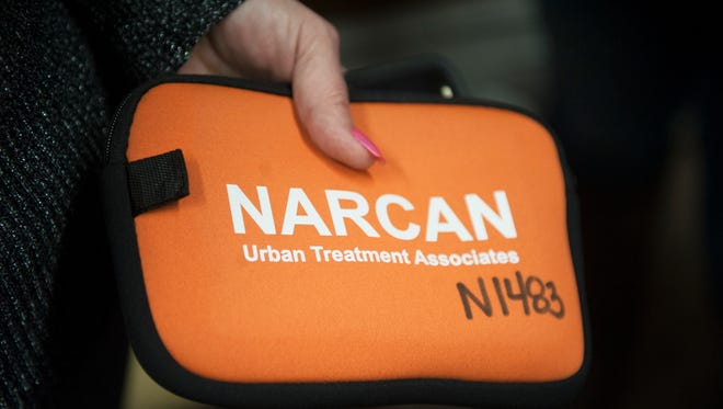 Lisa Vandegrift of Browns Mills holds a Narcan kit during a Narcan training class held at St. Mark Lutheran Church in Pemberton. Naloxone is used to reverse the effects of an opioid overdose, and is usually administered by rescuers using a nasal spray. Participants left with a free Narcan kit, thanks to a state grant.
