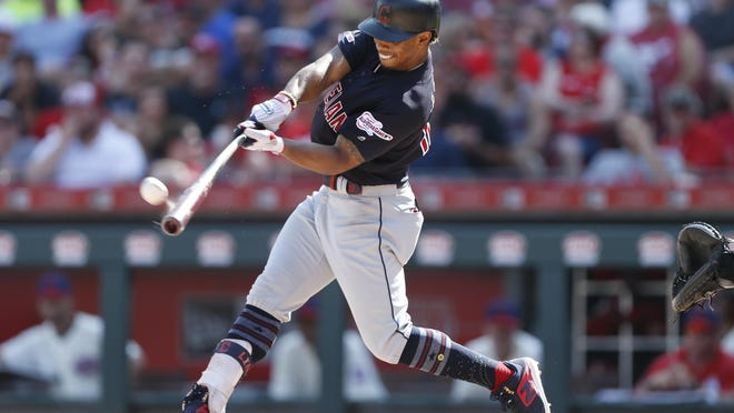 Cleveland Indians' Francisco Lindor connects on a solo home run, his second of the game, off Cincinnati Reds starting pitcher Anthony DeSclafani during the fifth inning of a baseball game, Saturday, July 6, 2019, in Cincinnati.