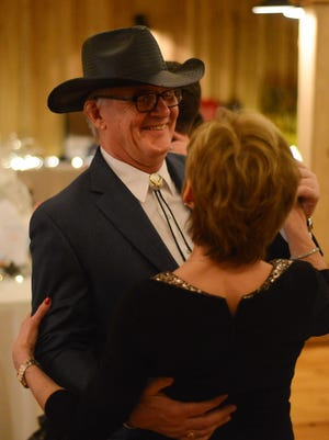 Bo Sweatman and Rhonda Thomas dance during the United Way of Sumner County's Boots & Bling Gala at the Bagsby Ranch in Gallatin on Saturday, March 5, 2016. The event was presented by TriStar Hendersonville Medical Center and Dollar General.