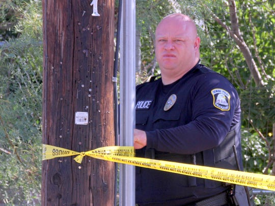 Deming police officer Derek Lovelace secured crime scene tape at the corner of Pearl and Olive streets Thursday morning where an apparent murder-suicide occurred early that morning.