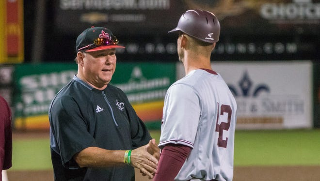 """Coach Tony Robichaux (left) and the Ragin' Cajuns face Coastal Carolina this weekend on M.L. """"Tigue"""" Moore Field at Russo Park."""