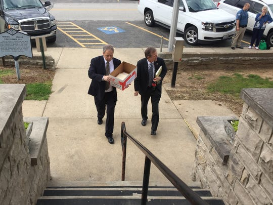 Prosecutors Kerry Chism, left, and David Ethredge arrive at the Marion County Courthouse Thursday morning at Yellville Courthouse for the fourth day of the Christina Scroggin murder trial.