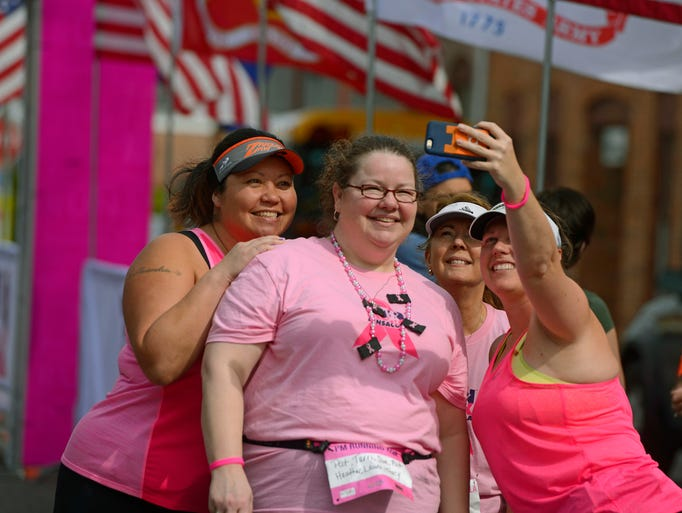 Runners take a selfie at the starting line Sunday before