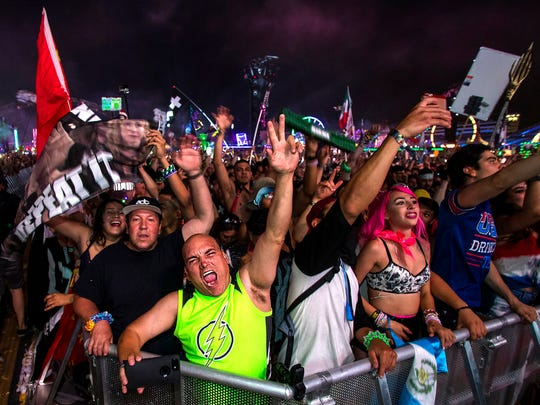 Spectators dance and cheer to the music by Martin Garrix at the Kinetic Field during the opening night of the Electric Daisy Carnival at the Las Vegas Motor Speedway in Las Vegas on Friday, June 16, 2017.