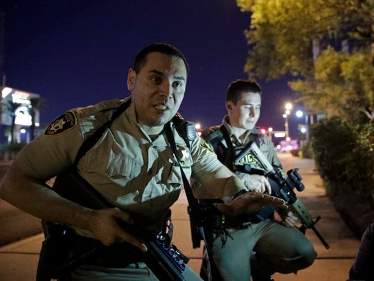 Police officers advise people to take cover near the