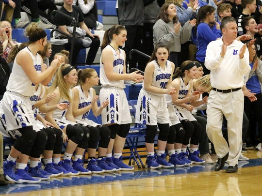Horseheads coach Andy Scott and players on the bench