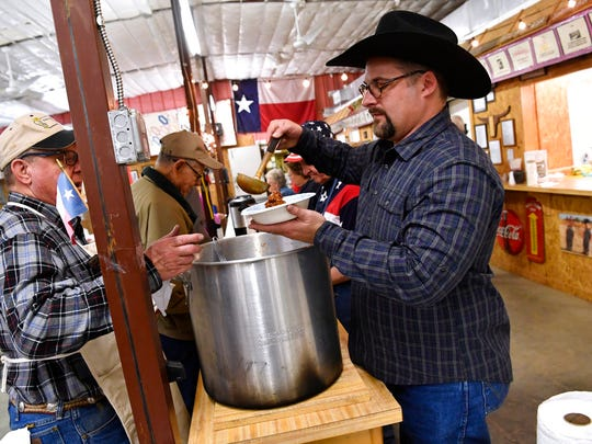 In this March 2, 2018, photo, Lance Perry serves chili during the Texas Independence celebration at the Merkel Area Historical Museum.