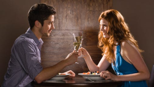 Couple toasts with wine.