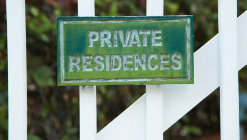 Private residences sign on gate