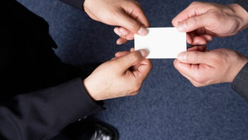 Businessmen Passing Business Card
