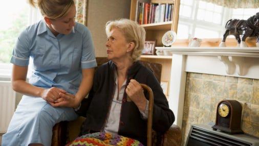 Volunteer visiting woman