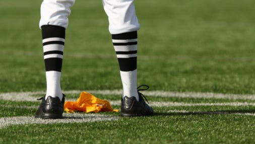 Two New Jersey high school football referees who walked off the field in protest of four players taking a knee during the national anthem will not work any postseason games.