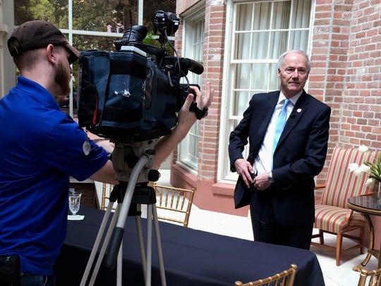 Arkansas Gov. Asa Hutchinson prepares for a TV interview