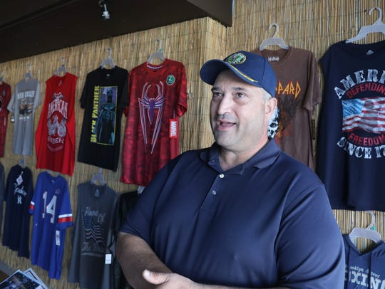 Bruce Ben-Dov inside his new T-shirt shop, Trump's Team Deplorable Community Activity Center, on Main Street in Webster on Wednesday, July 4, 2018.