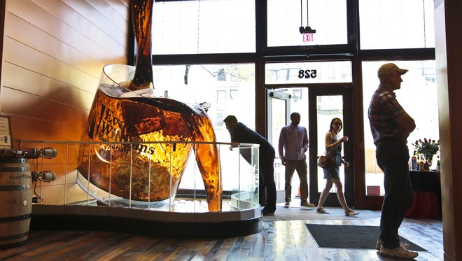 Visitors to The Evan Williams Bourbon Experience are greeted by a giant bourbon glass on the main floor. Bourbon is one of the state's six pillars of tourism: horses, bourbon, music, arts, outdoors and food.