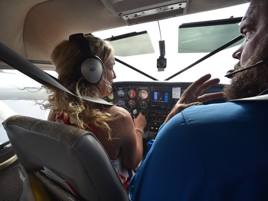 Penny Tranchilla (left) of Vero Beach, takes control of the seaplane under instruction from pilot Michael Hoover, of Treasure Coast Seaplanes, as they fly back to the Vero Beach Regional Airport on Friday, Oct. 6, 2017, after visiting Blue Cypress Lake in western Indian River County as part of their aerial tour.