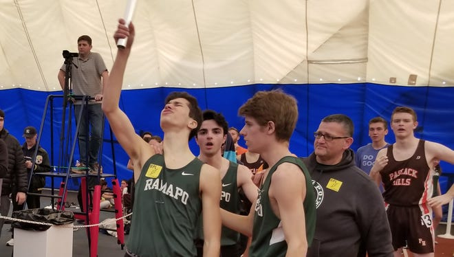 Michael Petrazzuolo points the baton to the sky after Ramapo's boys 4 -x- 400 relay team wins, honoring the memory of teammate, Ben Landel, at the North 1, Group 2 state sectionals in Toms River on Saturday, Feb. 3, 2018. Landel died of rare form of cancer on Jan. 25, 2018.