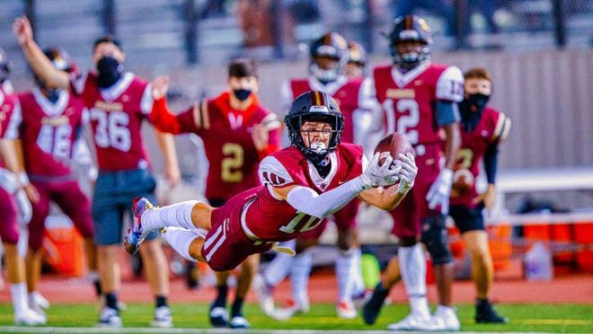 Rouse Raiders wide receiver Jalen Becerra, dives for the pass reception against the Weiss Wolves earlier this year, had a big game in a win over Elgin with five catches for 186 yards and a pair of touchdowns.