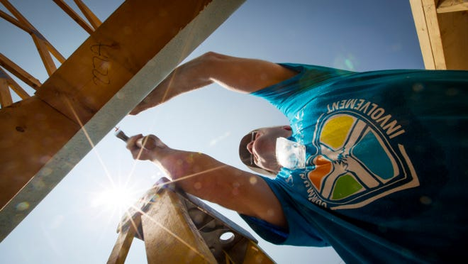 Jim Pioch, a volunteer with the Sammons Financial Group in West Des Moines, helps construct a Habitat for Humanity home at 1815 Washington Ave. in Des Moines on July 30. Since 2009, Habitat for Humanity has built 123 houses in Des Moines, including 14 through July.