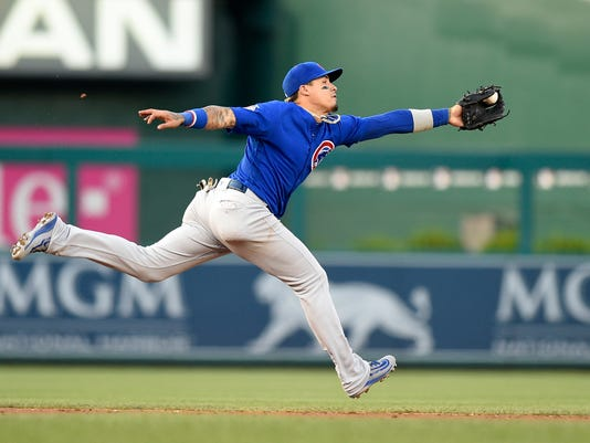 Chicago Cubs shortstop Javier Baez catches a single by Washington Nationals' Trea Turner during the third inning of a baseball game, Monday, June 26, 2017, in Washington. (AP Photo/Nick Wass)