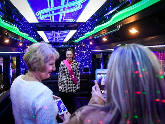 Jodie McCalllister gets her picture made by Kim McCallister (left} and Jenet Bauley in an SUV Limousine at the 10th annual Wedding & Prom Expo sponsored by the Evansville Courier & Press and held at the Old National Events Plaza Sunday.