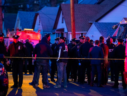 Police work in a neighborhood in the Queens borough