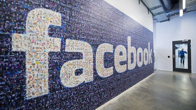 A big logo created from pictures of Facebook users worldwide is pictured in the company's Data Center, its first outside the US on November 7, 2013 in Lulea, in Swedish Lapland. T