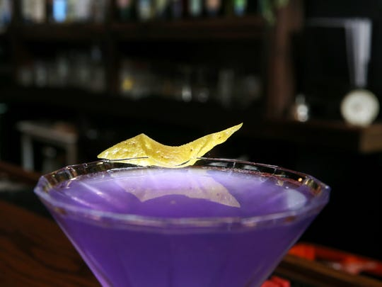 The Frenchie cocktail, featuring Sobieski vodka, lavender syrup, lemon and cuvee, served at the bar at Roux in the Park Avenue neighborhood of Rochester.