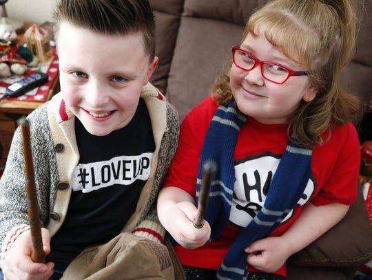 Harry Potter fan Xavier Kennedy (left), 9, raised money