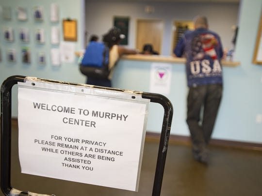 Guests sign up for services during the intake process at the Sister Mary Alice Murphy Center for Hope on Tuesday, July 11, 2017.