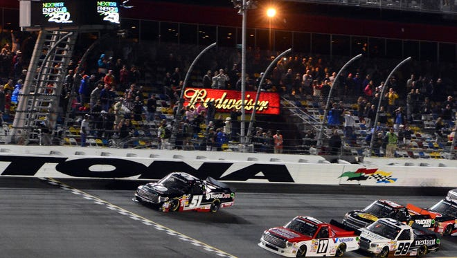Kyle Busch beats Timothy Peters to win the NextEra Energy Resources 250 at Daytona International Speedway.