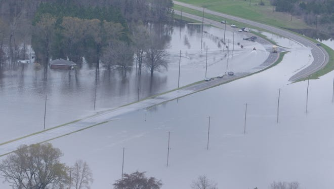 U.S. 425 is underwater after levees were topped about eight miles north of Bastrop on Saturday.