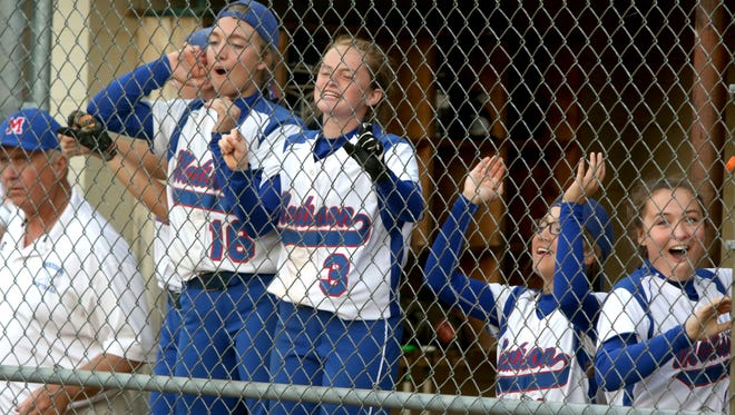 Madison players cheer from the dugout during Wednesday's extra-innings loss to West Wilkes in Marshall.