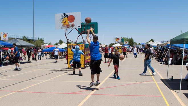 Basketball warmups at the Gus Macker 3 on 3 basketball tournament.