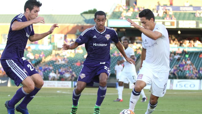 Louisville City FC's George Davis IV and Kyle Smith challenge the Harrisburg City Islanders' James Thomas for the ball. LCFC would go on to a 1-1 draw.