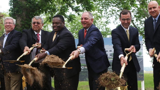 Left to right: Chris McGrath, the Senior Director of DHL, Ouachita Parish Police Juror Jack Clampit, Mayor Jamie Mayo, Gov. John Bel Edwards, Graphic Packaging CEO Michael Doss, and Scott Sureddin, the CEO North America of DHL Supply Chain, toss dirt during a groundbreaking ceremony at the site of the new Graphic Packaging facility on Millhaven Road in Monroe, Friday, April 28, 2017.