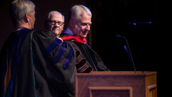Among the many happenings during this spring's university graduations, First Baptist Church pastor Phil Christopher was awarded an honorary doctorate and a hood from Hardin-Simmons University on May 12.