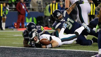 Philadelphia Eagles quarterback Carson Wentz (11) fumbles the ball near the goal line and into the end zone as Seattle Seahawks' Earl Thomas (29) and Sheldon Richardson (91) moved in in the second half Sunday.