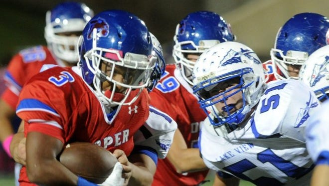 Cooper's Tyrees Whitfield (3) runs by San Angelo Lake View defense Friday, Oct. 28, 2016.