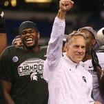 Michigan State coach Mark Dantonio celebrates after the 16-13 win against Iowa in the Big Ten Championship earlier this month at Lucas Oil Stadium in Indianapolis.