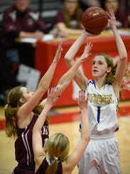 Cathedral's Kate Tomczik gets a shot off over Sauk
