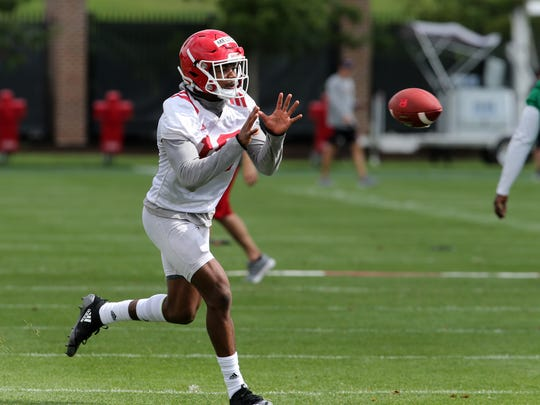 Rutgers' Bo Melton (#18) runs drills during the first training camp practice at Marco Battaglia Practice Complex at Rutgers University in Piscataway, NJ Friday August 3, 2018.