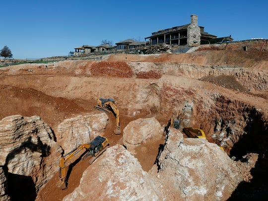 What started as a 70-foot wide sinkhole has now been excavated to a 200-foot wide, 100-foot deep hole at Top of the Rock golf course in Branson. Crews have removed 25,000 truckloads of rock and soil revealing large pillars of rock.